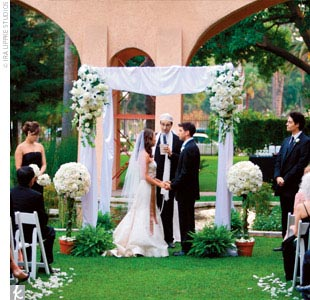They held their ceremony at sunset in the propertys garden and asked a rabbi who specializes in interfaith ceremonies (Michael is Jewish, and Annie is Christian) to officiate. A huppah was set up in front of the gardens koi pond, and traditions from both religions were incorporated into the vows, including a lighting of the unity candle and the b ...