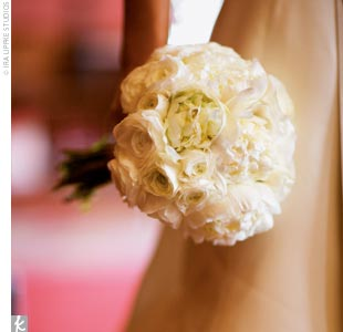 The bridal bouquet consisted of Annies favorite flowers -- white peonies and ranunculus -- and was hand-tied with the same sable ribbon used on her gown.