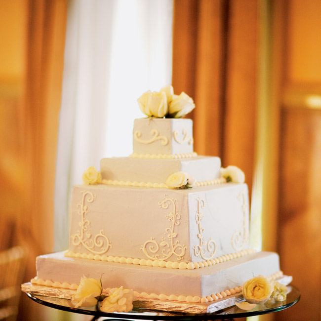 The bride and groom cut into their four-tiered chocolate chiffon cake with raspberry filling.
