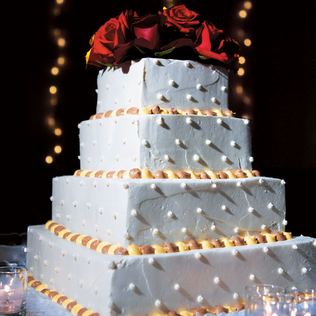 Nicole and Ryan chose a four-tiered cake, decorated with small beads of brown and gold chocolate icing for their reception.