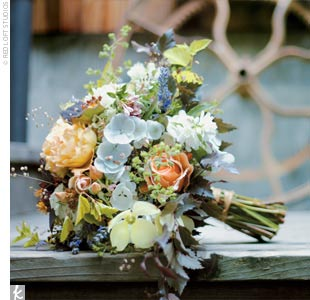 Almost all of the flowers for the wedding were picked from the apple farm and arranged by owner Karen Bates.