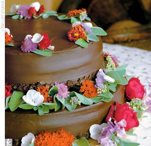 """We ordered two round cakes, both covered in a chocolate ganache icing,"" Karin says. The bottom cake was a hot-milk sponge cake with brandy, pastry cream, and fresh berries, while the top layer was a rich chocolate cake with chocolate mousse and a thin layer of apricot."