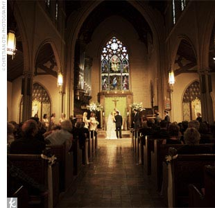 "The traditional Catholic ceremony took place at a beautiful church just three blocks from Elizabeth and Kevin's apartment.  ""It was nice to get married in the same neighborhood where we had lived for the past seven plus years,"" says Elizabeth."