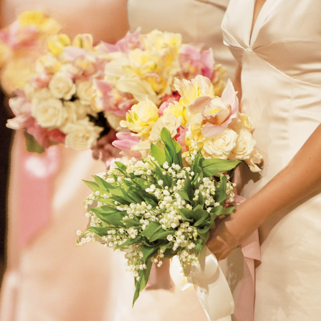 The bridesmaid bouquets were delicate and muted -- a simple mix of pink and pastel roses with a few orchids peeking through.