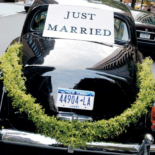 The newlyweds hopped into a black antique Rolls-Royce for a scenic tour of the city on their way to the reception site.