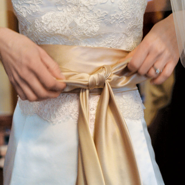 Amy added a lace jacket and champagne silk sash to her gorgeous ivory silk gown.