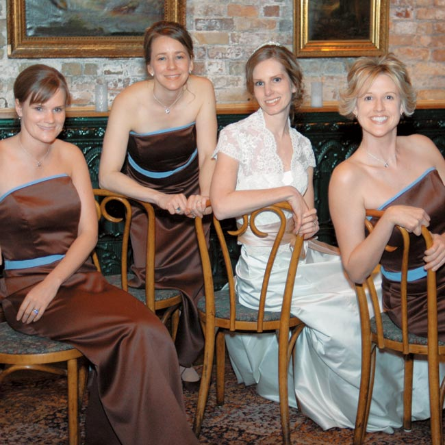 Amy's bridesmaids wore strapless, espresso-colored gowns with blue ribbon sashes.