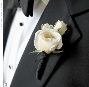 The groom wore a white rose boutonniere.