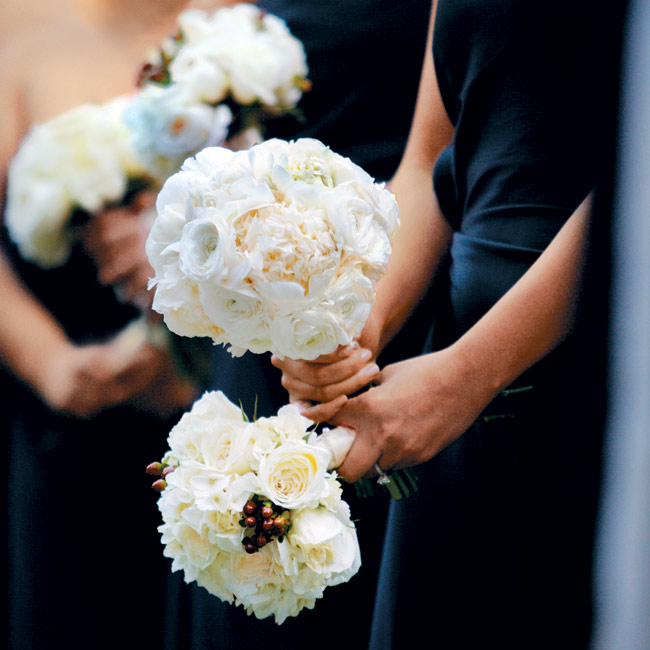 Annie's bridesmaids carried elegant bouquets of white blooms.