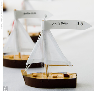 Little brown sailboats served as the place card holders for Liz and Jason's 100 guests. Guests also received custom-designed lobster bibs for the buffet-style lobster bake dinner.