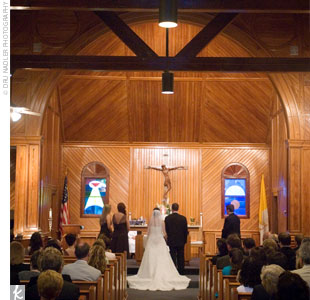 Liz and Jason wed in a Catholic ceremony at St. Andrew's Roman Catholic Church on Block Island. They found an old photo of the church from the 1940s that they featured on the covers of their ceremony programs.