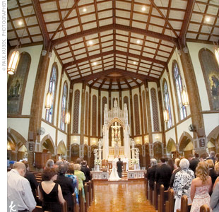 The intimate ceremony was held at St. Alphonsus Catholic Church in a building more than 150 years old, replete with high cathedral ceilings and stained-glass windows.  The groom's great-uncle, who is a priest, co-celebrated the nuptials.