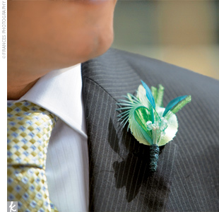 The milliner who created Shayna's hairpiece also made a matching feather boutonniere for Chris.
