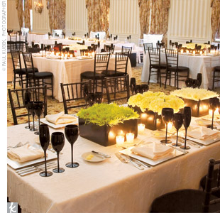 Rectangular and square tables, white linens, sleek black glassware, silver chargers, and black chiavari chairs set the stage for the modern yet decidedly elegant celebration.