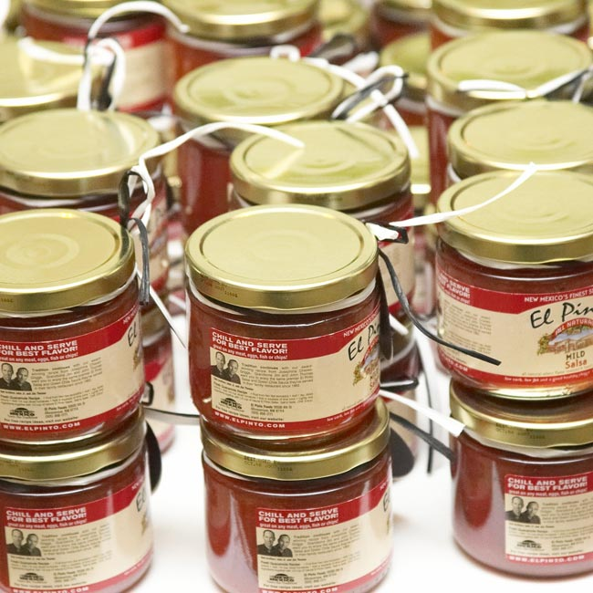 Before the bride and groom drove off in a black-and-white Ford Excursion, they had yet one more treat for their guests -- jars of salsa from their favorite restaurant in Albuquerque (where they had spent two summers together).