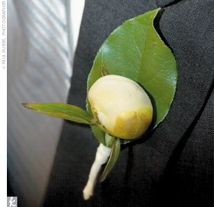 To match the bridal party's lush white peony bouquets, Ryan and his groomsmen wore single peony buds.