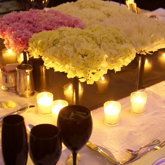 Each table was topped with three to six large, square, black vases packed with colorful, lush flowers.