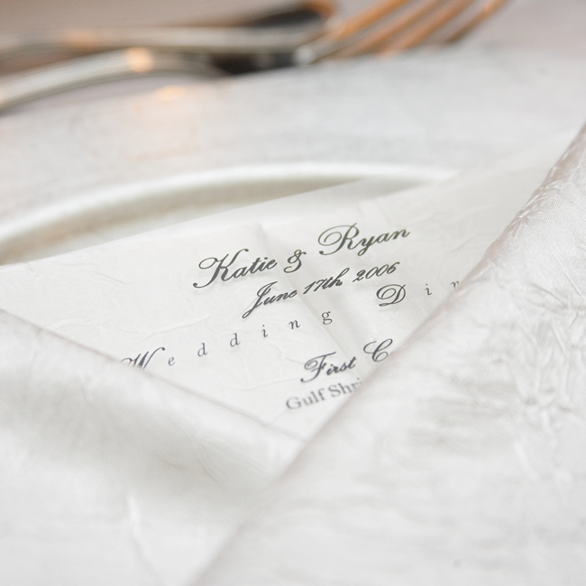 Designed to match the invitations, the classic black-and-white menus featured the evening's fare: rack of lamb and vegetarian lasagna.