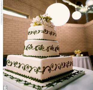 Shayna and Chris opted for a classic white wedding cake in alternating square and round tiers punctuated with their green logo.