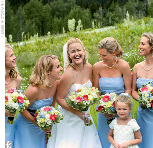 Stephanies four bridesmaids wore sky blue strapless silk-satin dresses that came to just below the knee and featured a chocolate brown organza sash.