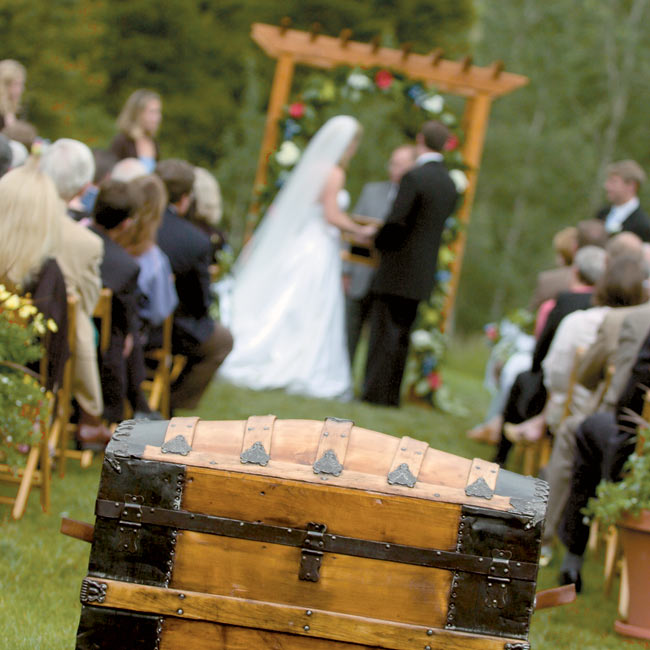 "A special moment in the ceremony came when the officiant, Greg's godfather, presented the couple with an antique steamer trunk he had had restored for them, and which their guests had filled with letters to the bride and groom. ""After we got home from our honeymoon, we'd read two or three of them before we went to bed,"" Stephanie remembers. ""It has ..."