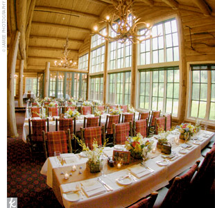 "The rustic, lodge-style ambience was set off by candlelight and low centerpieces of orchids and bear grass. ""I really wanted our guests to be able to see and talk to each other across the tables,"" Stephanie explains. The intimate style of the reception turned out just perfectly, and guests danced the night away out on the deck (beneath a tent, natu ..."