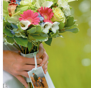 The bouquet included white hydrangeas, green orchids, white calla lilies, green mums, and pink gerbera daisies. Stephanie also incorporated a photo of her father, who had passed away, into the arrangement.