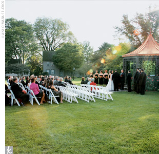 Jenn and Jason initially wanted an at-home wedding, but since their backyard wasn&#39;t big enough for their 100 guests, they chose The Dearborn Inn for its gazebo and outdoorsy setting. The surrounding flowers made for a natural, garden look so that no extra decor was needed for the space.