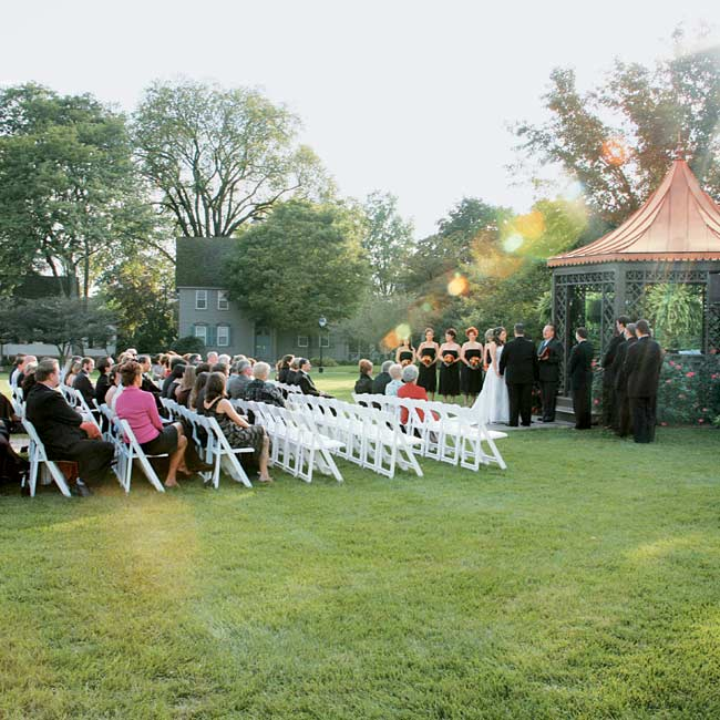 Jenn and Jason initially wanted an at-home wedding, but since their backyard wasn't big enough for their 100 guests, they chose The Dearborn Inn for its gazebo and outdoorsy setting. The surrounding flowers made for a natural, garden look so that no extra decor was needed for the space.