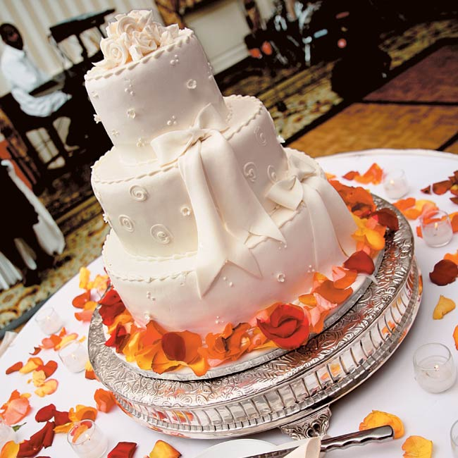 Following the toasts, the couple cut into a three-tiered vanilla and chocolate cake frosted in classic white icing and surrounded by rose petals.