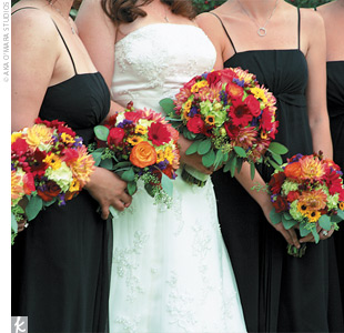 Jenn&#39;s only flower request were gerbera daisies, which were mixed with other vibrant blooms to create the bridal party&#39;s bouquets.