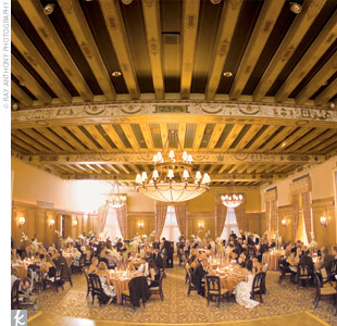 The couple envisioned a classic wedding with a palette of ivory and dark chocolate brown accented by shades of gold and copper. At the Detroit Athletic Club, ivory floral centerpieces topped each of the reception tables.
