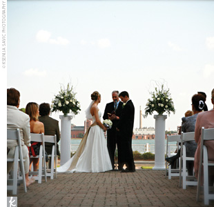 Jessica and Drew were married on a picturesque brick patio overlooking the Detroit River and city skyline as the sun set behind them.