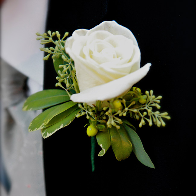 The groom and groomsmen wore hypericum berry and eucalyptus boutonnieres.