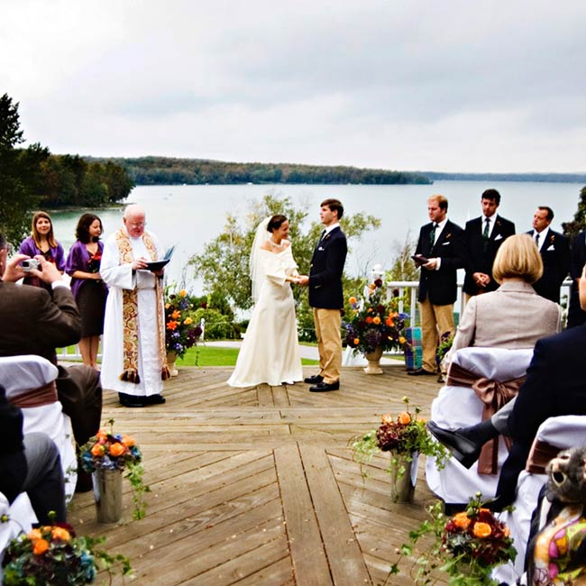 The ceremony was held on the outside deck of the Leland Country Club, which overlooks Lake Leelanau. Wendy walked up from the bottom of a hill to the deck surrounded by the changing fall leaves.