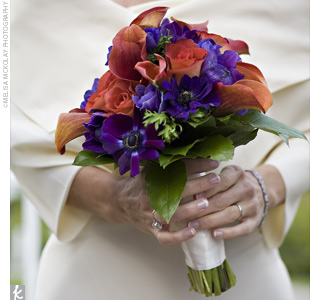 Wendy carried a loose hand-tied arrangement of Leonidas roses, purple anemones, and mango mini calla lilies.