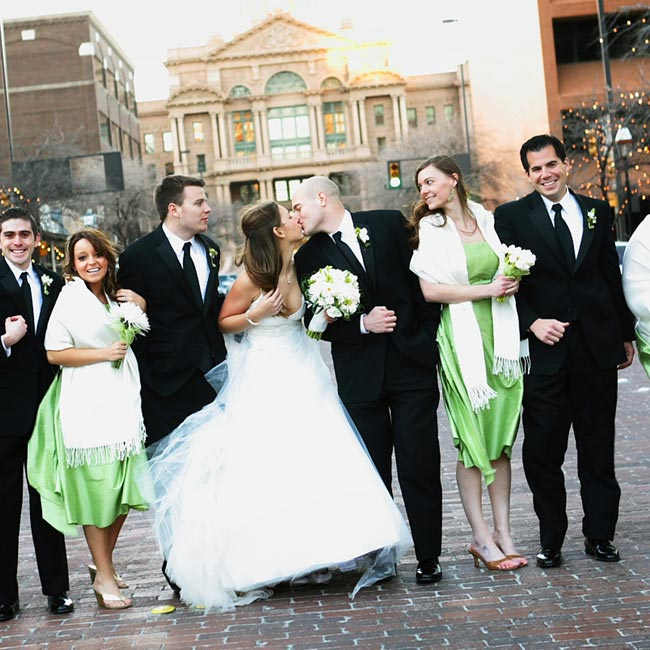 Dori's four bridesmaids wore strapless tea-length dresses in Midori green. The Watters & Watters dresses also featured ballet-style wrap sashes. Jason looked sharp in his tux and Dori looked beautiful in her gown.