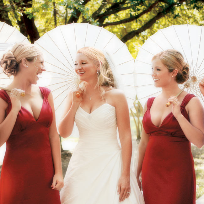 Julie's five maids wore floor-length garnet-hued dresses, while the bride wore a strapless A-line gown with a sweetheart neckline.