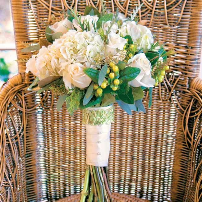 Ashley carried a larger version of the bridesmaid bouquets, except that hers was ivory with green accents. Her florist also wrapped a champagne-colored ribbon around her bouquet to coordinate with her gown.
