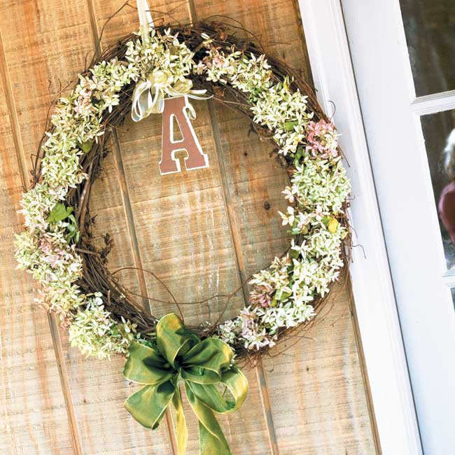 Ashley and Jeremy's decorative blooms adorned every aspect of their reception, including wreaths monogrammed A and J.