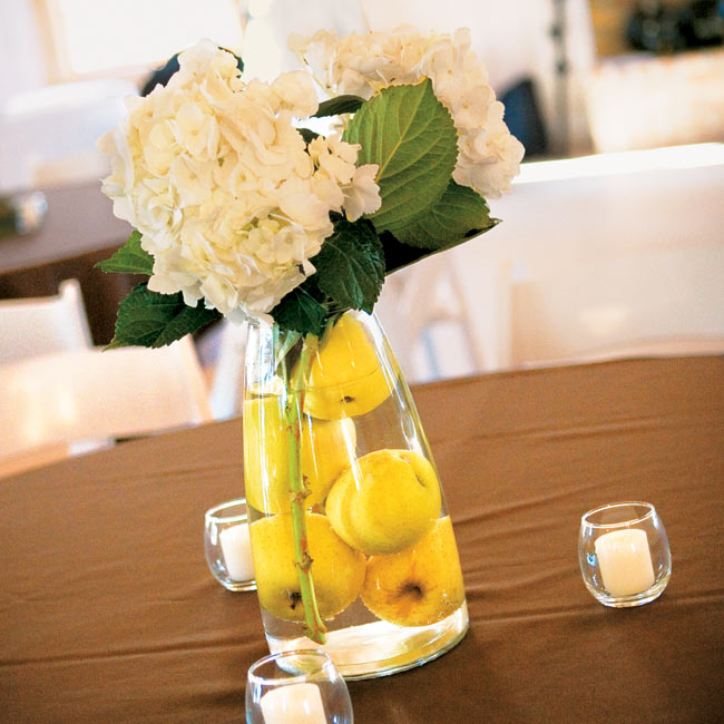 Ashley created the centerpieces with crab apples and cream-colored hydrangeas.