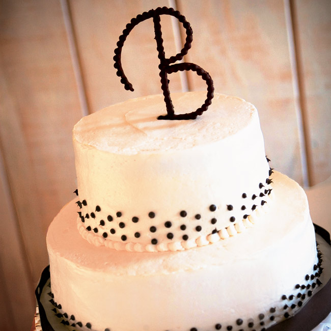 The two-tiered round cake was marble with chocolate ganache, and the outside was frosted with buttercream and topped with a B monogram made out of chocolate pearls.