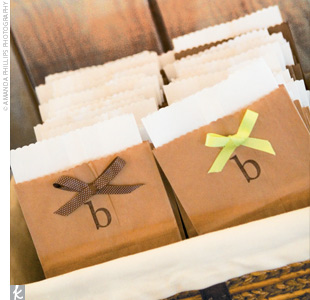 A candy bar was set up for all the guests to enjoy treats on their way home. Ashley and Jeremy included their favorite candies and placed them in glass jars. Small paper bags, with the couple's B monogram and brown and green ribbons, served as favor bags. In addition to the sweet treats, the couple gave out trees to be planted to symbolize their ne ...