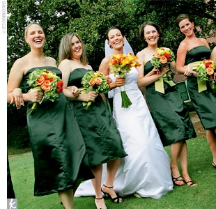 Diane chose strapless, dark green, knee-length dresses accented with chartreuse sashes by Watters &amp; Watters for her bridesmaids. To keep things comfortable, the bridesmaids wore their own shoes for the ceremony.