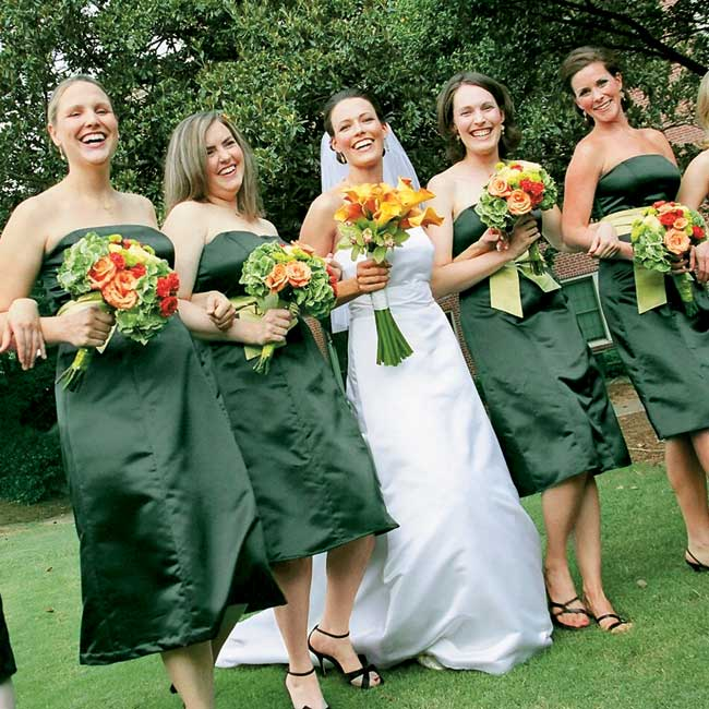 Diane chose strapless, dark green, knee-length dresses accented with chartreuse sashes by Watters & Watters for her bridesmaids. To keep things comfortable, the bridesmaids wore their own shoes for the ceremony.