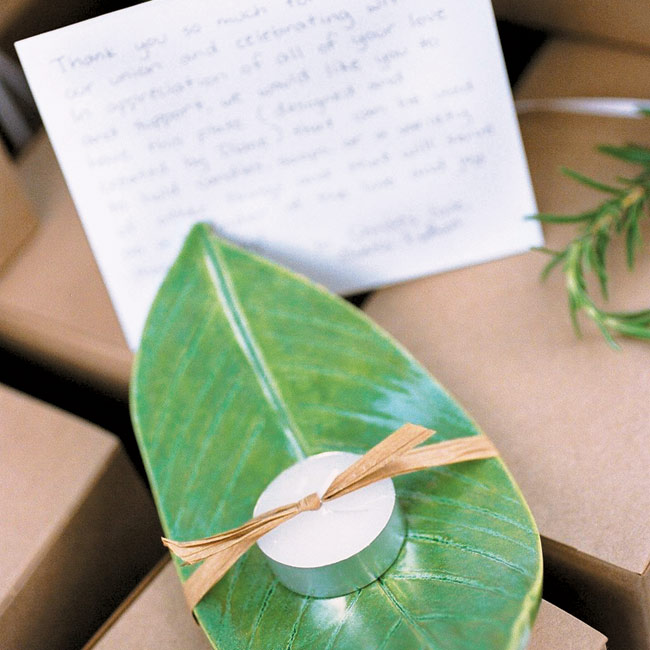 As soon as they were engaged, Diane set to making 200 ceramic plates, which she pressed and shaped like peace lily leaves and then stamped with the wedding day design. She glazed each one with a green alligator glaze and tied them with a tea candle, as favors for her guests. The ceramic plate favors were attractively packaged in natural ivory boxes ...