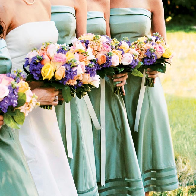 Picking up colors from the surrounding garden, the five bridesmaids wore cactus green, tea-length, Vera Wang dresses with bobbinet accents at the hem and ivory grosgrain belts.