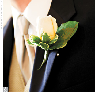 Rudy donned a simple ivory rose bud boutonniere.