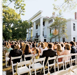 "The ceremony took place outdoors on the Taylor-Grady House grounds. As guests arrived at the ceremony, they were given sweet tea and lemonade to sip and programs that doubled as paper fans to keep cool in the warm summer air. ""We even had four couples greeting guests as they arrived, to show our southern hospitality,"" Carson says."