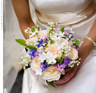 Jane carried a white bouquet with bursts of color that included roses, lily of the valley, stephanotis, and freesia.